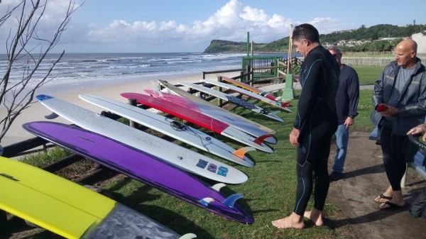 Mal Lewis checking out some longboards From Local Shaper Amos (600 x 337)